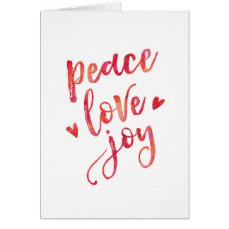 Cartão de Natal da tipografia da alegria do amor