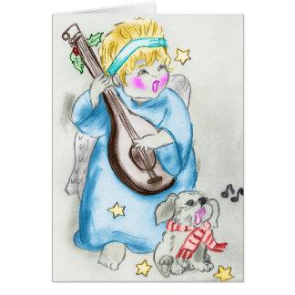 Cartão de Natal do anjo e do filhote de cachorro