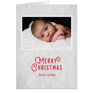 Cartão de Natal do bebê primeiro no papel rústico