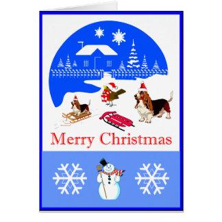 Cartão de Natal nevado do Basset e do pássaro