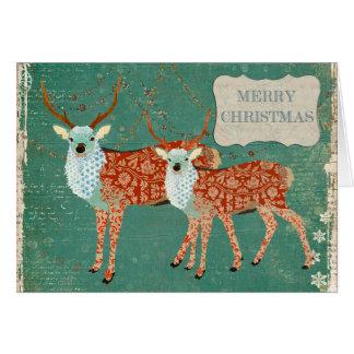 Cartão de Natal ornamentado ambarino dos cervos do