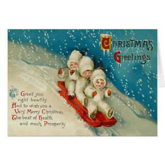 Cartão de Natal Sledding do bebê da neve do