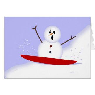 Cartão de Natal Sledding do boneco de neve