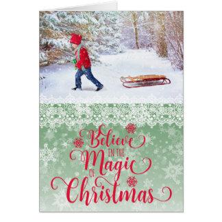 Cartão de Natal verde da foto do floco de neve