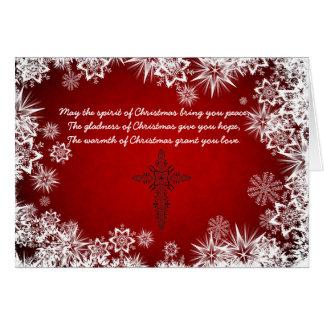 Cartão de Natal vermelho com os flocos brancos da