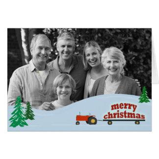 Cartão de Natal vermelho da foto do trator