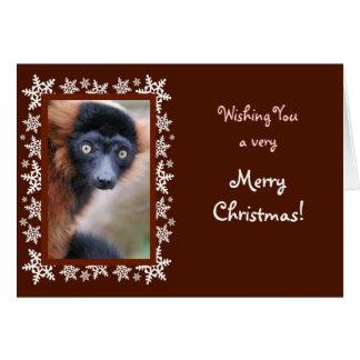 Cartão de Natal vermelho do Lemur de Ruffed