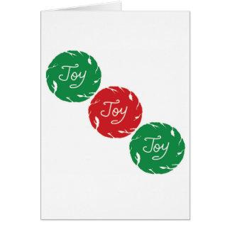 Cartão de Natal vermelho e verde da alegria