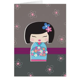 Cartão de nota da boneca de Kokeshi do japonês