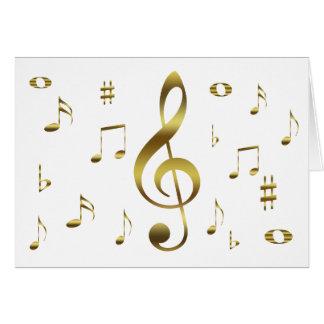 Cartão de notas musicais do ouro