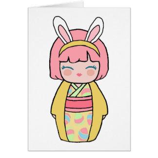 Cartão de páscoa amarelo de Kokeshi