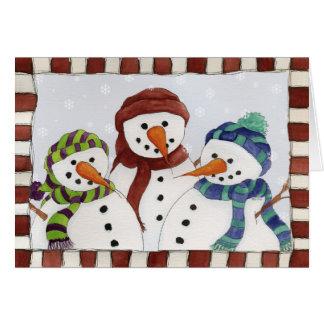 Cartão de três bonecos de neve