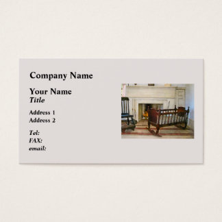 Cartão De Visitas Berço perto da lareira