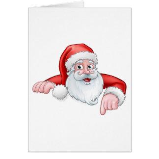 Cartão Desenhos animados do papai noel que apontam para