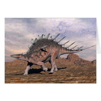 Cartão Dinossauro do Kentrosaurus no deserto - 3D rendem