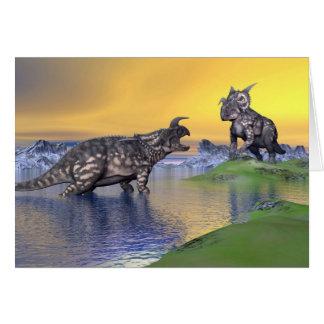 Cartão Dinossauros do Einiosaurus pelo por do sol - 3D