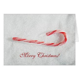Cartão do bastão de doces do Natal por Janz