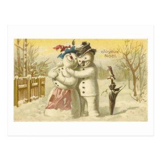 Cartão do boneco de neve & da mulher de Joyeux Noe Cartão Postal