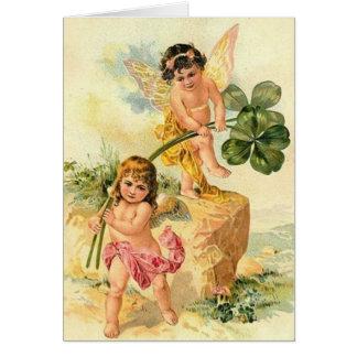Cartão do dia de St Patrick dos querubins do
