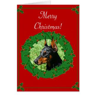 Cartão do Doberman do Feliz Natal