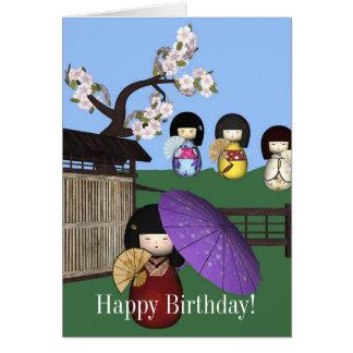 Cartão do feliz aniversario das bonecas de Kokeshi