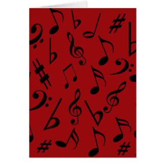Cartão do feriado das notas musicais - vermelho
