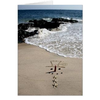 Cartão do feriado do Natal da praia do boneco de