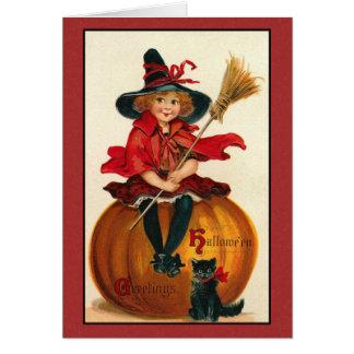 Cartão do gato e da menina do Dia das Bruxas do