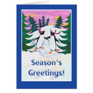 Cartão do GreetingChristmas da estação, pinguins