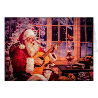 Cartão do Natal com papai noel do canto