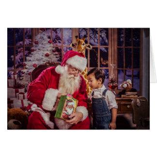 Cartão do Natal com papai noel e menino