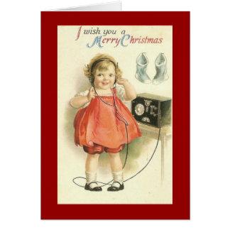Cartão do Natal da menina de telefone do vintage