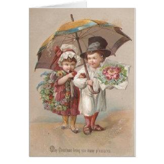 Cartão do Natal do casal do Victorian