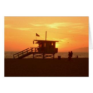 Cartão do por do sol da estação do Lifeguard