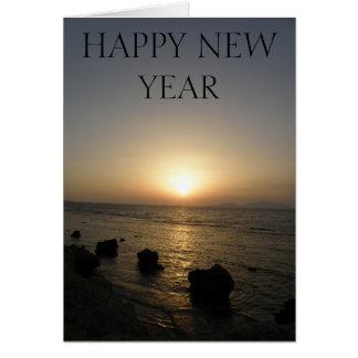Cartão do por do sol do feliz ano novo