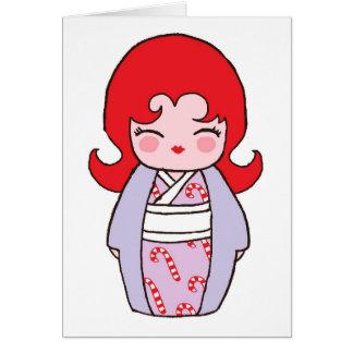 Cartão do Xmas de Kokeshi Candycane