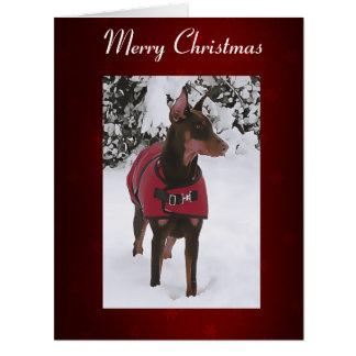 Cartão Doberman vermelho na neve (fita v11-1)