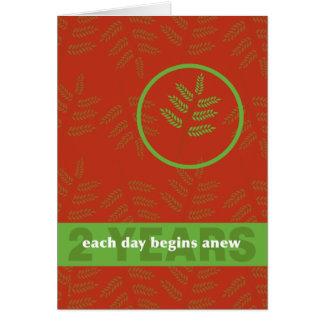 Cartão Dois anos um o dia em uma folha nova da