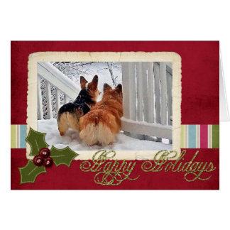 Cartão Dois Corgis de Galês na neve com quadro do feriado