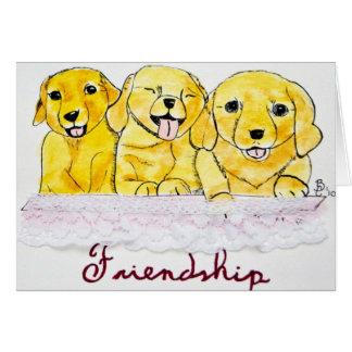 Cartão dos filhotes de cachorro da amizade