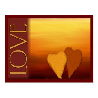 Cartão dourado do amor do por do sol