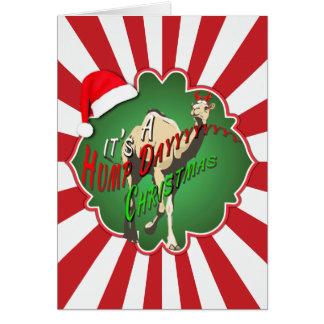 Cartão É um vermelho Starburst do camelo do Natal do dia