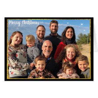 Cartão Elementos do ouro & do quadro do Natal da foto de