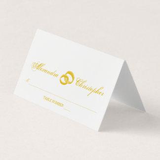 Cartão entrelaçado do lugar de dois anéis de ouro