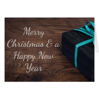 Cartão Cartão envolvido elegante do presente de Natal