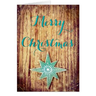Cartão Estrela de madeira do Natal da textura do Feliz