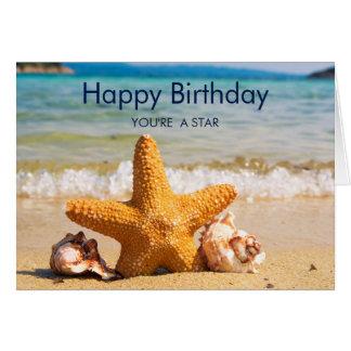 Cartão Estrela do mar e Seashells no aniversário da praia