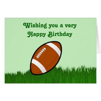 Cartão Feliz aniversario com futebol na grama
