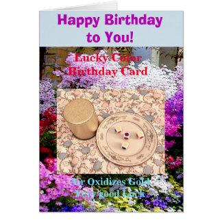 Cartão Feliz aniversario da cor afortunada. O ar