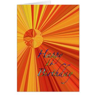 Cartão Feliz aniversario que flui o Sunburst alaranjado &